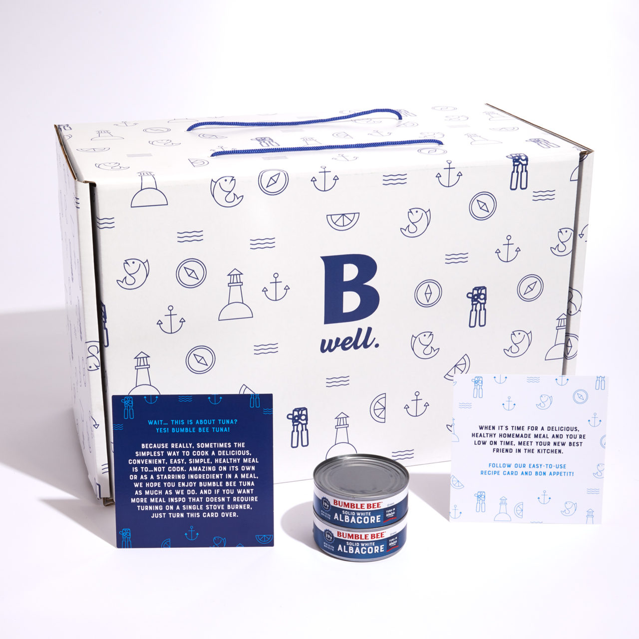 White influencer box with cans and cards
